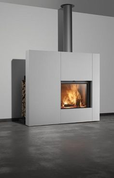 The frameless Stuv 21 heralds a new sophistication in built-in fireplace design with its unique retractable glass door. Free the fire with Stuv and Oblica. Fireplace Inserts, Wood Fireplace, Fireplace Surrounds, Fireplace Design, Fireplaces, Retractable Door, Freestanding Fireplace, Surface Area, Glass Panels