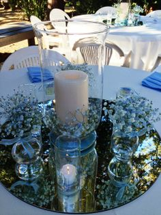 """Baby shower guest table centerpieces were designed from my rental inventory using 17"""" hurricane candle holders with a blue babies breath wreath, bud vases and votive candle holders on 22"""" mirrors...pretty, simple, and stylish! Flowers and decor by Seasonal Celebrations. http://www.seasonalcelebrations.com"""