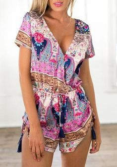 Front shot of tanned woman wearing an ethnic plunge chiffon drawstring romper