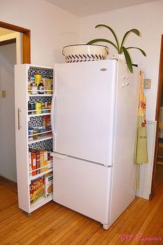 Brilliant space-saving DIY hack for a small kitchen - a pullout rollout pantry right next to the refrigerator. GREAT idea for small kitchen. Lots more space-saving ideas here: http://outintherealworld.com/diy-home-kitchens-tiny-kitchen-decor-remodeling-ideas-love/