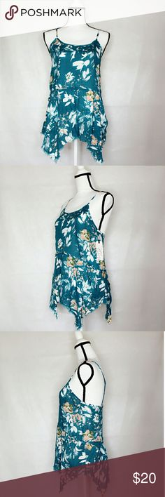 Melrose and Market Teal Floral Asymmetrical Tank This is a Melrose and Market Teal Floral Asymmetrical Camisole Top. It is NWT / new with tags and has never been worn. From Nordstrom, priced $26.97. This is in size XS. I also have another in my closet, but in Green if you don't like the foral. Go check it out! The green I have in both XS and L. Nordstrom Tops Camisoles