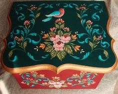 There is more detail in the roses and comma strokes are built up to create depth on this beautiful example of Hindeloopen Folk Art