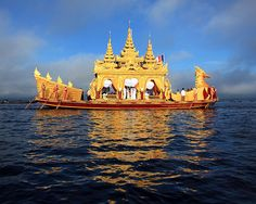 Boat Carrying Buddha Statues | Flickr - Photo Sharing!
