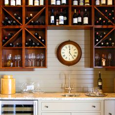 No wine cellar? Create one by hanging cabinet boxes on a wall. Wines can be stored either vertically on open shelves or horizontally in boxes fitted with diagonal dividers.