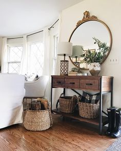 Vignette for cabinet. Maybe a round mirror on one side and round clock on the other?