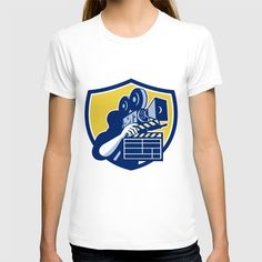 Cameraman Vintage Movie Camera Clapboard Shield Retro T-shirt Illustration of a cameraman movie director holding vintage movie film camera and clapboard set inside shield crest on isolated background done in retro style. #illustration #CameramanVintage