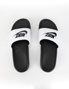 Synthetic leather strap with jersey lining for comfort and durability. Textured footbed massages your feet for a soothing feel. Foam sole for soft, lightweight cushioning. All Nike Shoes, Black Nike Shoes, New Shoes, White Nike Slides, Cheap Cute Shoes, Nike Slide Sandals, Nike Shirts Women, Black And White Nikes, Black Sandals