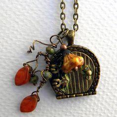 Hobbit Door - Hobbit Locket Necklace - Bilbo Baggins - Hobbit Hole Door - The Hobbit Jewelry , Fairy door. $35.00, via Etsy.