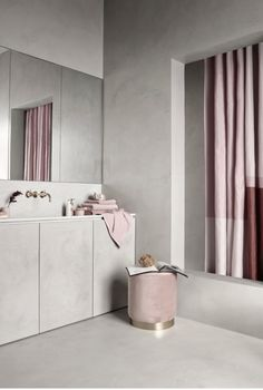 Harmony: The walls, floor and counter are mostly the same color, and the curtain, and stool match. Both colors are pretty subdued, but give the room a little variation.