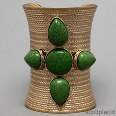 """CHUNKY GREEN ACRYLIC GOLD TONE CUFF BRACELET              *BRACELET MATCHES A NECKLACE SET THAT I HAVE FOR SALE IN MY STORE. PLEASE CHECK FOR AVAILABILITY IF YOU ARE WANTING AN ENTIRE SET*                                   SIZE: 3 3/4"""" HIGH                     COLOR: GOLD TONE  $20.99"""