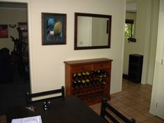 1. recently bought the wine rack from PK Furniture, the mirror was an xmas gift from the folks, I think from the Warehouse and the painting, pretty much the only art I own that is framed, I think is something the folks bought in Australia.    I so want to replace the dining table and chairs, is next on my hit list.