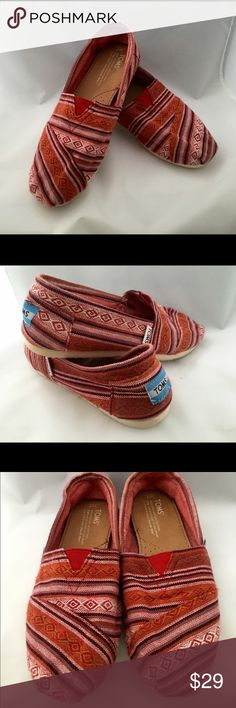 Toms Classic Women's 7 Classic style Toms shoe in women's size 7! I've been in a wheelchair since I've had these so wear is very minimal. Red pattern in wool blend material (not canvas). TOMS Shoes Flats & Loafers