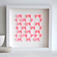 Un joli cadeau à fabriquer soi même pour la fête des papas : un tableau avec des coeurs en papier