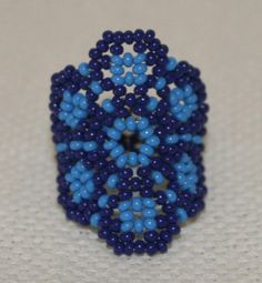 This Blue Flower Chaquira Ring is in colors of blue and light blue. Making this ring came out looking great when finished. The two colors combined together look just splendid. I like this ring so much I had to make two of them. Ring Finger Size: 6 to 7 Flower width: 1.25 Please also note that there may be minor imperfections due to the handmade quality. Feel free to message me with any questions you may have. Thanks enjoy.