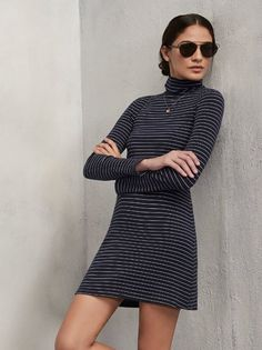 We gave you a little more up top and a little less on the bottom with this one. The Rochelle Dress is the perfect thing to take you into those colder months. This is a medium weight ribbed jersey mini dress with long sleeves and a raw-cut turtleneck. The fabric has some great stretch - fits tight in all the right places then flares out a bit in the skirt.  Made from 88% tencel, 12% sapndex.
