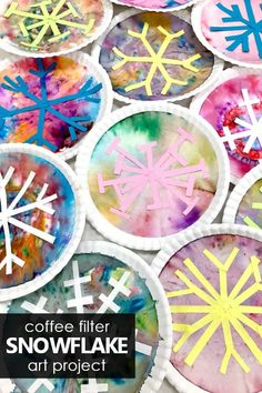 Need a fun winter art project idea? Engage even the most reluctant little artists with this fun twist on making coffee filter snowflake art with kids. #kidart #kidsartprojects #kidscrafts #winter #preschool #kindergarten