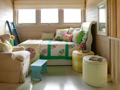 Cheerful prints and natural lighting provoke a carefree feel in the kids' loft. The twin bed includes a trundle bed to maximize sleeping capacity without taking up space. The mismatched quilts fulfill the cottage look that fits with the rest of the house. Accent Chairs For Living Room, Formal Living Rooms, Living Spaces, Dining Room, Bedroom Night, Bedroom Decor, Bedroom Kids, Master Bedroom, Colorful Bedding