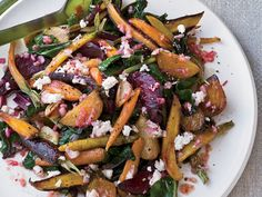 Roasted Beets and Carrots with Goat Cheese Dressing | Whisking goat cheese with vinegar and oil is an ingeniously easy way to make a creamy dressing for warm roasted vegetables.