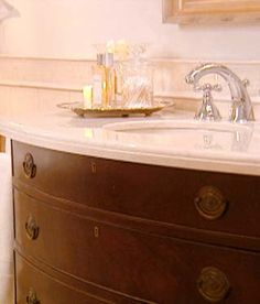 I love the idea of repurposing old dressers and vanities for bathrooms