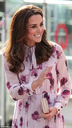Kate waves to onlookers as she leaves the London Eye...
