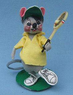 """Annalee 7"""" Tennis Boy Mouse:  Doll features Open eyes, open mouth - as shown, grey body, black hair, green and white visor, yellow shirt, white sneakers, holds tennis racket, green base. See other tennis companions G424 and 2310."""