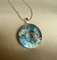 Butterfly on Watercolors Washer Pendant Necklace from Two Cheeky Cats $5.99