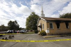 """By Therese Apel  JACKSON, Miss. (Reuters) - A historic black church in Mississippi was burned and spray-painted with """"Vote Trump"""" and authorities said on Wednesday it was arson and being probed as a hate crime committed one week before the U.S. presidential election.  Greenville Fire Chief"""