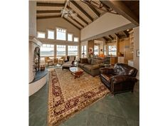 Stunning custom waterfront home on the beach on tranquil Samish Island. Enjoy gorgeous sunsets, clamming, boating & 66' of water frontage.3556 SF, 3 BR, 2.5 Ba, this home has seaside flair and tasteful upgrades. Chef's Kitchen w-custom maple cabinetry & built-ins, rich granite & premium appliances. Open floor plan anchored by stucco-stone FP. Walls of windows to emphasize the views. Automatic Generator. This custom beach house is an easy 90 minute drive from Vancouver BC & Seattle. No…