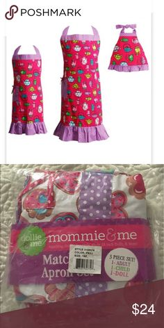 Mommie & Me Matching Apron Set The actual set is the second photo, used the first to compare prices only. The set includes an apron for Mommy, Child, and Doll. Item is from a smoke free and pet free home, still in plastic, however plastic was torn open by my daughter. Mommie & Me Other
