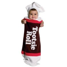 """Tootsie Roll Bunting Costume Rasta Imposta. $13.99. Polyester; cold wash. Approximately 21 1/2"""" from neck to drawstring at legs. Baby Tootsie Roll Costume. Poly-Fleece Bunting. spot clean only. Bunting (3-9 Months). Brown, White and Red"""