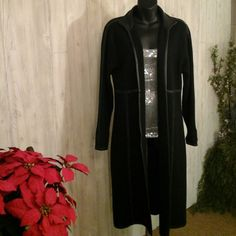 """Beautiful sweater jacket with leather trim Black. Wool and leather. Not scratchy wool feels and looks more like a sweater type fabric. Length is 43"""" from shoulder seam to bottom.  Sleeves are 19"""" in length.  Excellent condition. Andrea jovine Sweaters"""