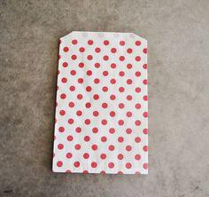 red polka dot favor bags (10 bags). $6.00, via Etsy.
