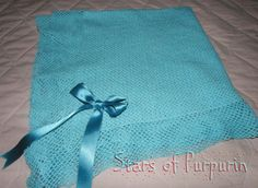 Baby Blanket in aquamarine blue color with a ornament of satin tie also in aquamarine blue.