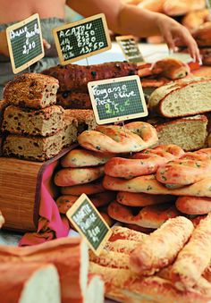 Freshly baked gourmet breads in an outdoor French market. #food