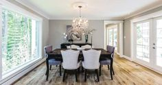 The chandelier over the dining table is the only remnant from the original house. The floors are engineered oak by Laurentian Hardwood in a shade called dusk. They were redone in wide planks with a matte finish to camouflage any dust or scratches.