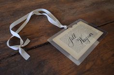I created these name tags/luggage tags/place cards from an old French book.  They make me smile.