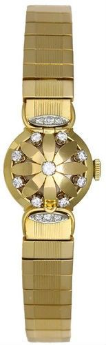 Gubelin Vintage 18k Gold & Diamond Manual Winding Ladies Flower Watch - Very unusual vintage manual winding ladies Gubelin wristwatch.  18k yellow gold case with flip-open flower petal shaped cover with diamonds over dial. This lovely watch has a silver dial with gold colored markers and 18k yellow gold bracelet that will fit 6-3/4-in. wrist. It is pre-owned, in exceptionally nice condition for its age.   Excellent condition with minor wear.  <b>Please contact Portero Customer Care..