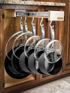 undercounter drawer organizer with pots and pans hanging illustrating The TOH TOP 100 Best New Home Products