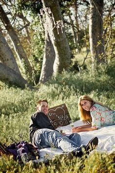 grassy meadow, wood sign, blanket... <3