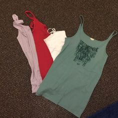 Tank top bundle All size small except for real tank from j crew size large. Red one is small from hollister. Purple is forever 21 and white is a cami with built in bra size small Tops Tank Tops