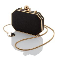 """Black Micro-sparkle Black VeganLeatherlining Gold plated hardware Ball and Gem Closure with a Swarovski Crystal Gold plated touch-up mirror Convertible chain shoulder strap 6 1/4"""" x 4 1/4"""" x 1 1/4"""" Made in Italy"""
