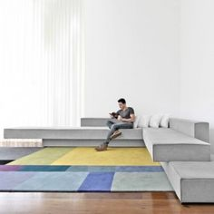 Cantilevered+sofas+by+Paulo+Kobylka+fit++together+like+stacked+concrete+slabs