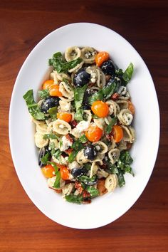 Pesto Pasta Salad with Cherry Tomatoes, Olives, and Feta