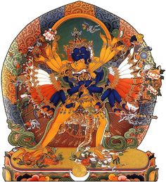 A Buddha named Kalacakra - Wheel of Time - with his partner (also herself a buddha). The male (yab) is method/compassion, the female (yum) is is wisdom.  [Tibetan Vajrayana Buddhism]