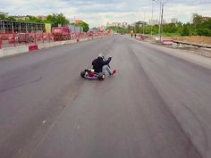 Drone shows handmade trike drifting on closed road under construction