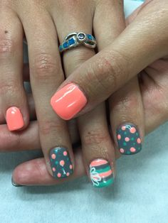 Super cute and fun soft orange, grey and dark mint solid/polka dot and striped gel polish over non-toxic/odorless hard gel with an very cute looped outline flower accent.