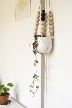 I've chosen simple materials and natural colours for this plant hanger. Born as project for my home is now here available for your home too.Natural leather colour, black, white.Natural leather, woodLength from top to the base of the pot75cmmCeramic vase, white, d12cm, h 11cm