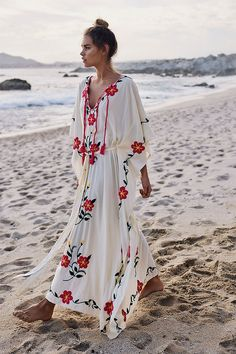 First thing to pack for your next vacation! Oversized kaftan featuring bold and colorful hand embroidered floral design. #resortwear #vacationfashion #dress #maxi #hippy #hippie #boho #bohemian #ad #comfy #beachy