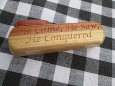 Handmade wooden Kazoo, with the saying He Came, He Saw, He Conquered. The body wood is Redwood, the top is Cedar. The screws are made out of brass. Size approx. 5 1/16 inch long x 1 5/8 inch tall x 1 1/4 wide. Available on Etsy at Spuzzowoodworking.com