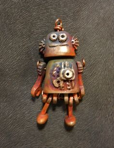 Myron the robot.  Jointed bronze clay- 2 inches tall- by Kathy Davis